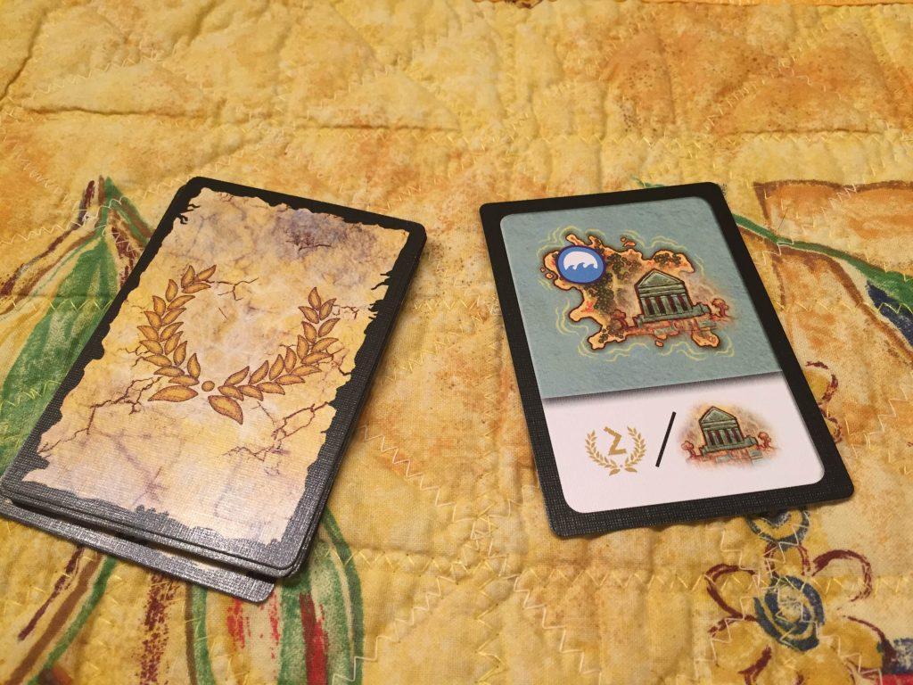 Uppdragskort. Detta uppdrag ger 2 segerpoäng för varje ö med en blå resurs och ett tempel har hittats.